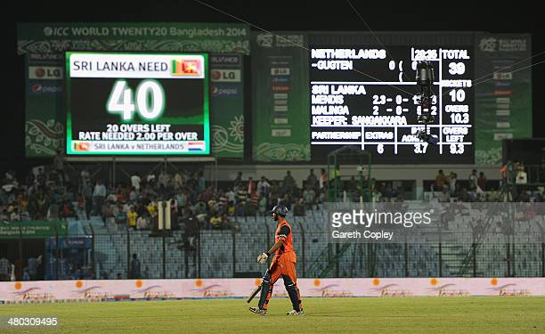 Ahsan Malik of the Netherlands leaves the field after his team is bowled out for 39 runs during the ICC World Twenty20 Bangladesh 2014 Group 1 match...