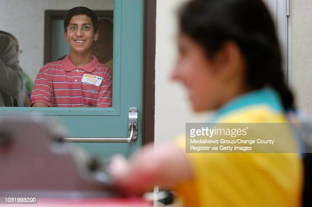 ANGELES Ahsan Masood left watches her sister Aiman Masood compete during The Braille Challenge Finals in Los Angeles Calif on June 23 2007