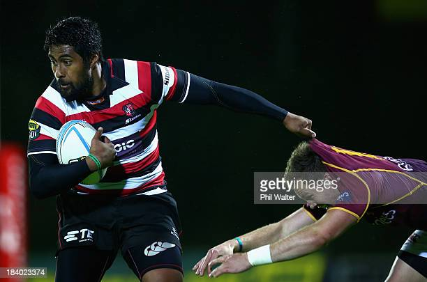 Ahsee Tuala of Counties is tackled by Marty McKenzie of Southland during the round nine ITM Cup match between Counties Manukau and Southland at...