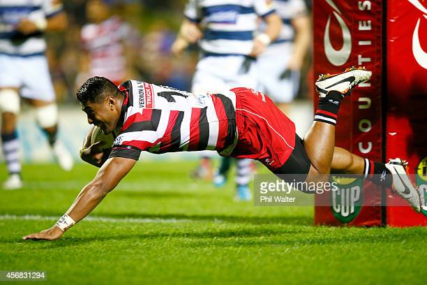 Ahsee Tuala of Counties scores a try during the round nine ITM Cup match between Counties Manukau and Auckland at ECOLight Stadium on October 8 2014...