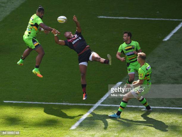 Ahsee Tuala of Northampton challenges Nathan Earle of Saracens during the Aviva Premiership match between Saracens and Northampton Saints at...