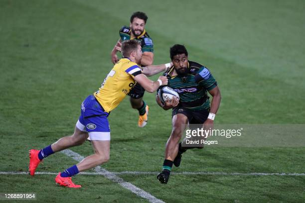 Ahsee Tuala of Northampton Saints battles with Ruaridh McConnochie of Bath during the Gallagher Premiership Rugby match between Northampton Saints...