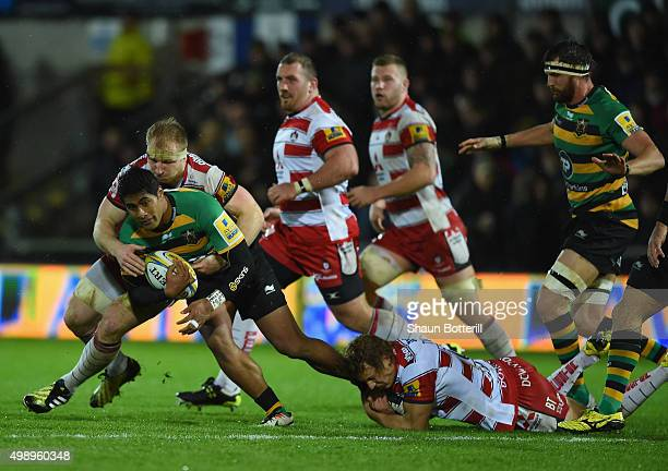 Ahsee Tuala of Northampton Saints is held up by the Gloucester Rugby defence during the Aviva Premiership match between Northampton Saints and...