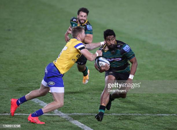 Ahsee Tuala of Northampton Saints is tackled by Ruaridh McConnochie during the Gallagher Premiership Rugby match between Northampton Saints and Bath...
