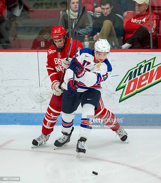Ahti Oksanen of the Boston University Terriers checks Sonny Milano of the USA National Junior Team during NCAA exhibition hockey at Walter Brown...