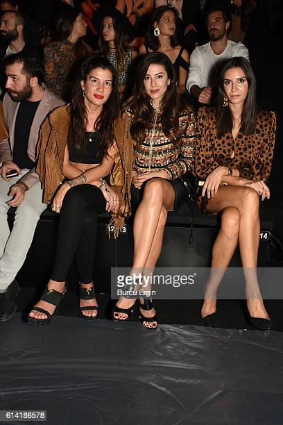 Ahu Yagtu and Basak Dizer attend the Ozgur Masur show for MercedesBenz Fashion Week Istanbul at Zorlu Center on October 12 2016 in Istanbul Turkey