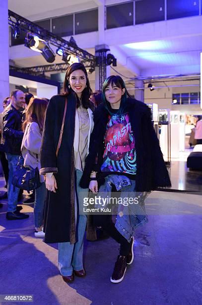Ahu Yagtu and Hande Cokrak attends Mercedes Benz Fashion Week Istanbul FW15 on March 18 2015 in Istanbul Turkey