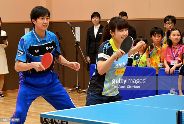 Ai Fukuhara And Chiang Hung-Chieh attend a table tennis class for children on January 25, 2017 in Matsuyama, Ehime, Japan.