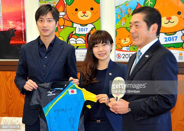 Ai Fukuhara and Chiang Hung-Chieh present a signed shirt to Ehime Prefecture Governor Tokihiro Nakamura prior to attending a table tennis class for...