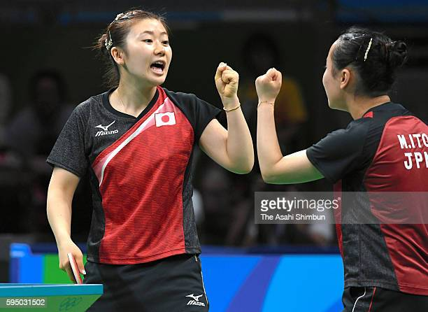 Ai Fukuhara and Mima Ito of Japan celebrate a point in a match against Mengyu Yu and Zhou Yihan of Singapore during the Women's Team Bronze Medal...