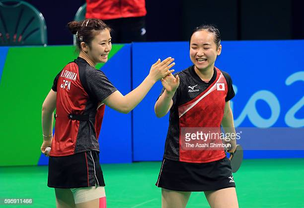 Ai Fukuhara and Mima Ito of Japan celebrate a point Zhou Yihan and Yu Mengyu of Singapore in the Table Tennis Women's Team bronze medal match on Day...