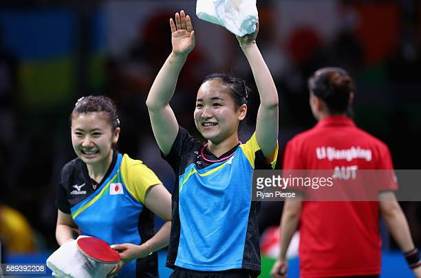 Ai Fukuhara and Mima Ito of Japan celebrate after winning match point against Austria during the Table Tennis Women's Team Round Quarter Final...