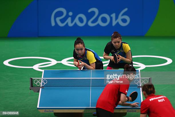 Ai Fukuhara and Mima Ito of Japan play against Austria during the Table Tennis Women's Team Round Quarter Final between Japan and Austria during the...