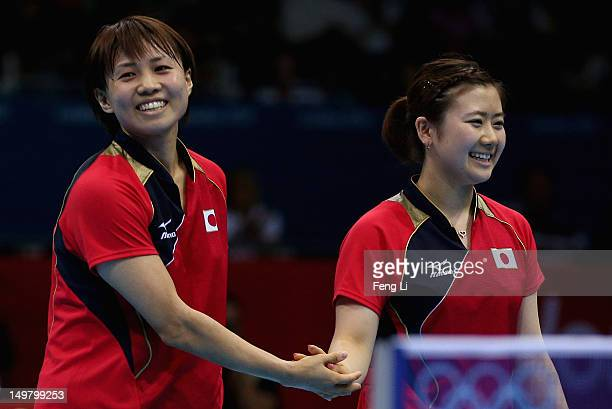 Ai Fukuhara and Sayaka Hirano of Japan celebrate winning after Women's Team Table Tennis quarterfinal match against team of Germany on Day 8 of the...