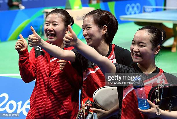 Ai Fukuhara Kasumi Ishikawa and Mima Ito of Japan celebrate winning the bronze medals after beating Singapore in the Table Tennis Women's Team bronze...