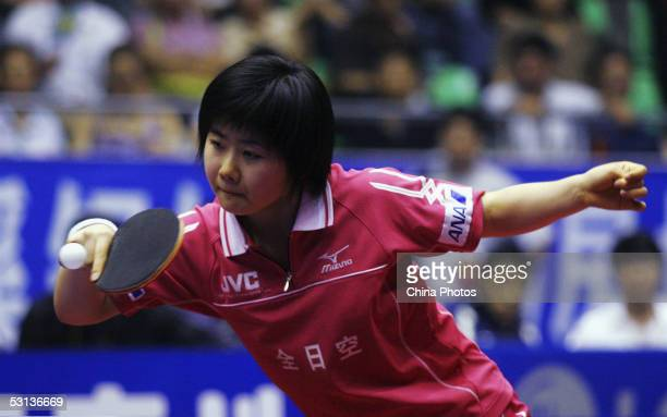 Ai Fukuhara of Japan a member of Liaoning Bengang Team returns a ball during a women's double match at China`s Luneng Cup Table Tennis Club Super...