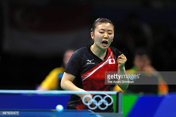 Ai Fukuhara of Japan celebrates a point against Tianwei Feng of Singapore during the Women's Singles Quarterfinal 4 Table Tennis on Day 4 of the Rio...