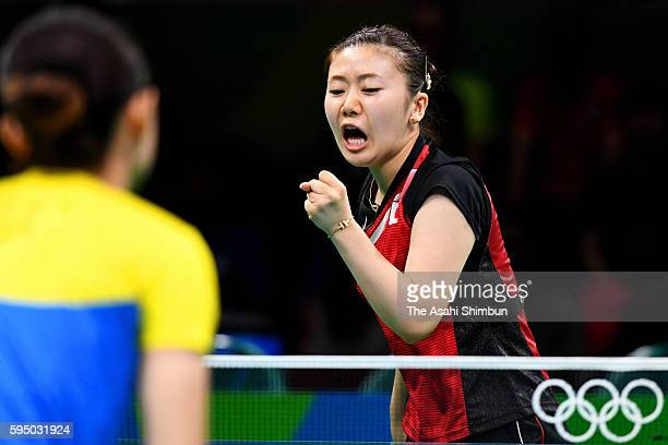 Ai Fukuhara of Japan celebrates a point in a match against Mengyu Yu of Singapore during the Women's Team Bronze Medal match on Day 11 of the Rio...