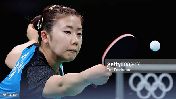 Ai Fukuhara of Japan competes against Daniela Monteiro Dodean of Romania during Round 3 of the Women's Singles Table Tennis on Day 3 of the Rio 2016...