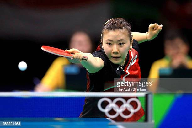 Ai Fukuhara of Japan competes against Tianwei Feng of Singapore during the Women's Singles Quarterfinal on Day 4 of the Rio 2016 Olympic Games at the...
