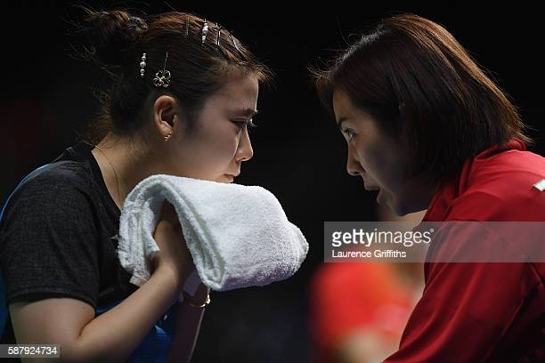Ai Fukuhara of Japan feels the pressure during her Womens Table Tennis Singles Semi Final match against Xiaoxia Li of China at Rio Centro on August...