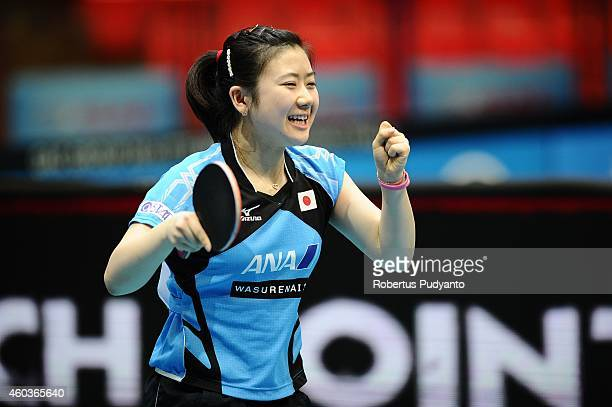 Ai Fukuhara of Japan reacts after defeating Morizono Mizaki of Japan during the Women's singles round of 16 of the 2014 ITTF World Tour Grand Finals...