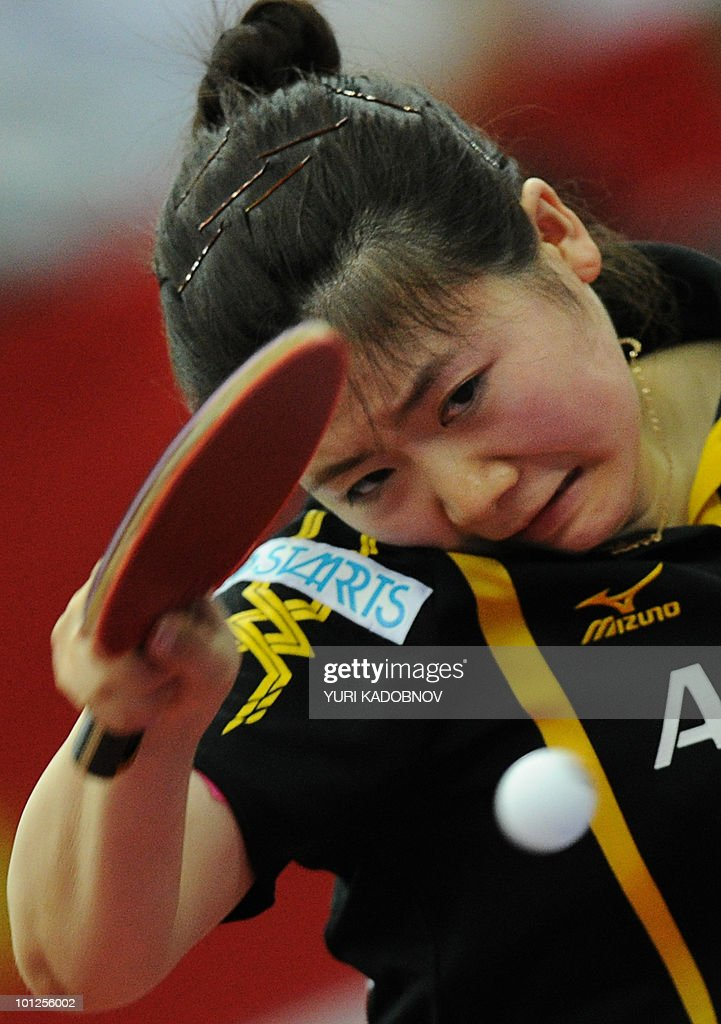 Ai Fukuhara of Japan returns a service to Ding Ning of China during the women's semi final at the 2010 World Team Table Tennis Championships in Moscow on May 29, 2010.
