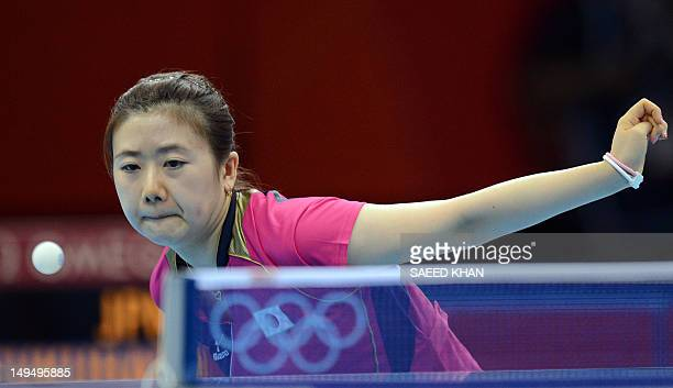 Ai Fukuhara of Japan returns a shot to Anna Tikhomirova of Russia during a table tennis women's singles round match of the London 2012 Olympic Games...