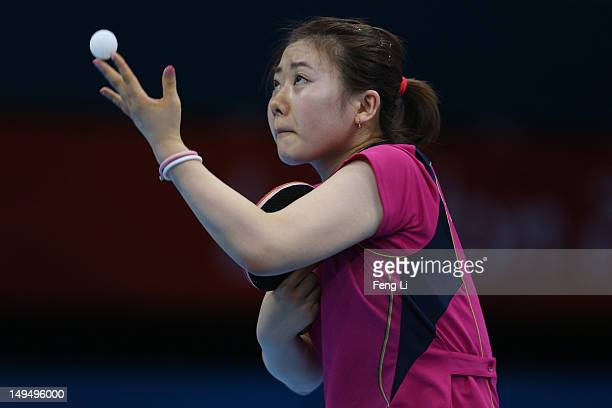Ai Fukuhara of Japan serves in her Women's Singles Table Tennis third round match against Anna Tikhomirova of Russia on Day 2 of the London 2012...