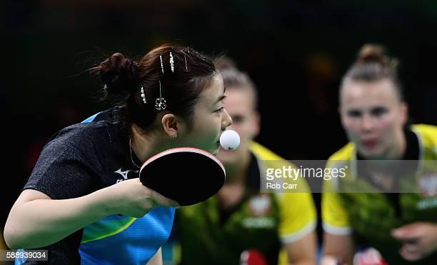 Ai Fukuhara of Japan serves to Natalia Partyka and Katarzyna GrzybowskaFranc of Poland during the Women's Team Round 1 on Day 7 of the Rio 2016...