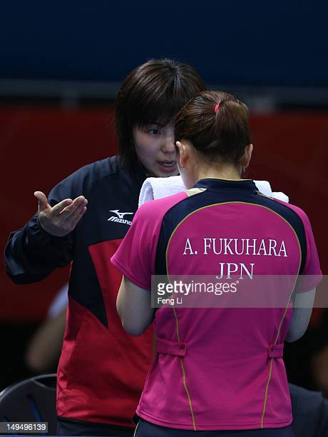 Ai Fukuhara of Japan speaks to the Japan team coach in her Women's Singles Table Tennis third round match against Anna Tikhomirova of Russia on Day 2...