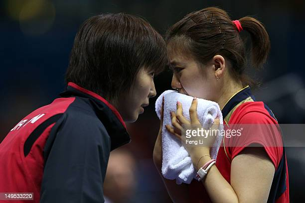 Ai Fukuhara of Japan speaks with her coach during her Women's Singles Table Tennis fourth round match against Jie Li of Netherlands on Day 3 of the...