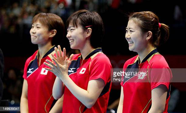 Ai Fukuhara Sayaka Hirano and Kasumi Ishikawa of Japan smiles before competing against China for the Women's Team Table Tennis on Day 11 of the...