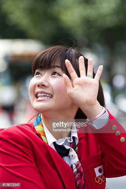 Ai Fukuhara waves from the top of a double decker bus during the Rio Olympics 2016 Japanese medalist parade in the ginza district on October 7, 2016...