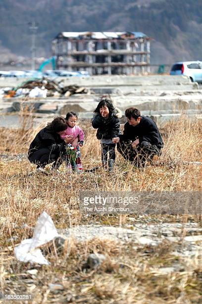 Ai Iyama and her family visit the place where their house used to stand on March 10 2013 in Otsuchi Iwate Japan Her father and elder brother are...
