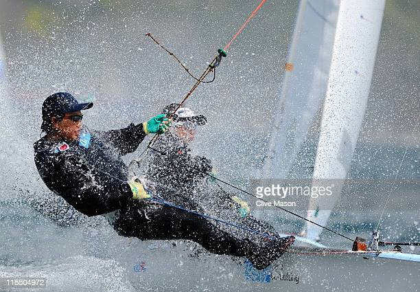 Ai Kondo and Wakako Tabata of Japan in action during a Womens 470 class race on day two of the Skandia Sail For Gold Regatta at the Wemouth and...