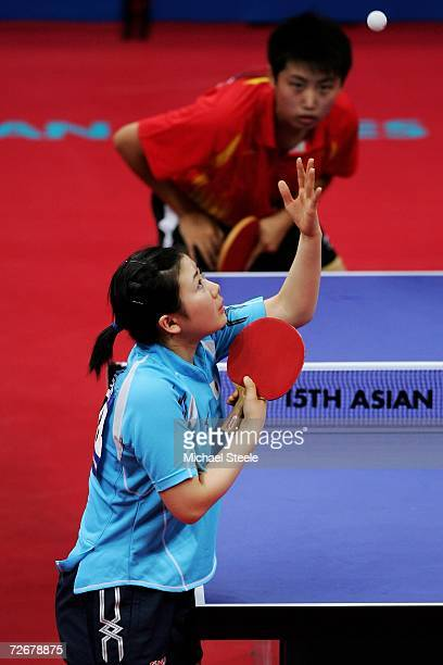 Ai Kukuhara of Japan serves to Guo Yue of China during the Women's Table Tennis Team Quarter Finals at the 15th Asian Games Doha 2006 at Al-Arabi...