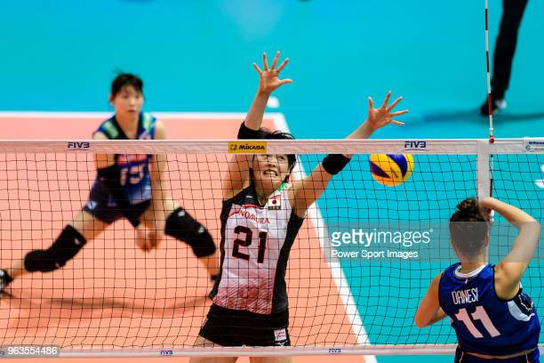 Ai Kurogo of Japan blocks Anna Danesi of Italy during the FIVB Volleyball Nations League Hong Kong match between Japan and Italy on May 29 2018 in...