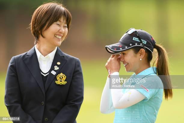 Ai Miyazato of Japan and the chairman of LPGA Japan Hiromi Kobayashi smile during the final round of the Suntory Ladies Open at the Rokko Kokusai...