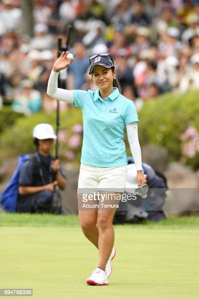 Ai Miyazato of Japan celebrates after making her putt on the 18th hole during the final round of the Suntory Ladies Open at the Rokko Kokusai Golf...