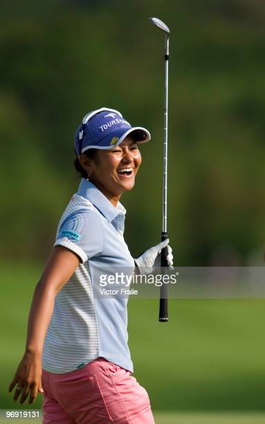 Ai Miyazato of Japan celebrates after sinking a chip shot on the 18th green during the final round of the Honda PTT LPGA Thailand at Siam Country...