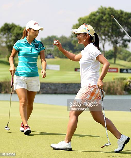 Ai Miyazato of Japan celebrates her victory while Momoko Ueda watches during the final round of the HSBC Women's Champions at the Tanah Merah Country...