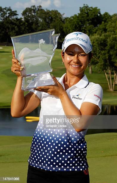Ai Miyazato of Japan celebrates with the trophy after winning the Walmart NW Arkansas Championship at Pinnacle Country Club on July 1 2012 in Rogers...