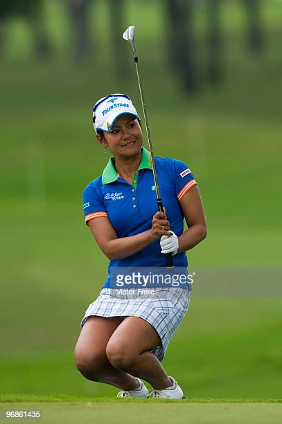 Ai Miyazato of Japan chips onto the 10th green during round two of the Honda LPGA Thailand at the Siam Country Club on February 19 2010 in Chon Buri...