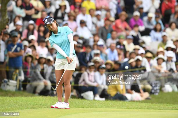 Ai Miyazato of Japan chips onto the 18th green during the final round of the Suntory Ladies Open at the Rokko Kokusai Golf Club on June 11 2017 in...