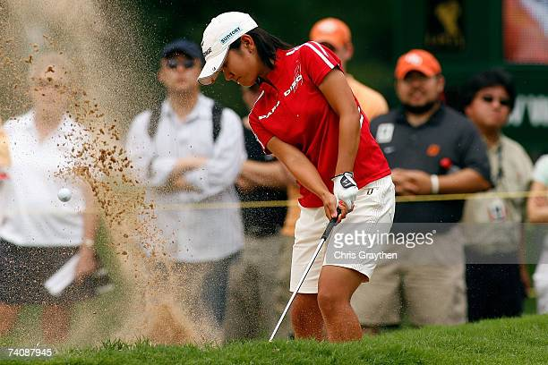 Ai Miyazato of Japan chips out of the sand on the 18th hole during the final round of the SemGroup Championship presented by John Q Hammons on May 6...