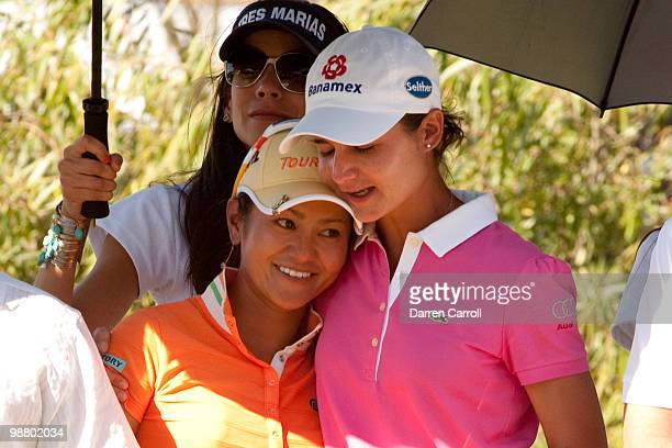 Ai Miyazato of Japan embraces Lorena Ochoa of Mexico after the fourth round of the Tres Marias Championship at the Tres Marias Country Club on May 2...