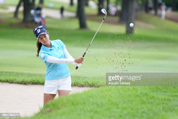 Ai Miyazato of Japan hits from a bunker on the 12th hole during the final round of the Suntory Ladies Open at the Rokko Kokusai Golf Club on June 11...