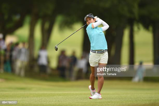 Ai Miyazato of Japan hits her second shot on the 1st hole during the final round of the Suntory Ladies Open at the Rokko Kokusai Golf Club on June 11...