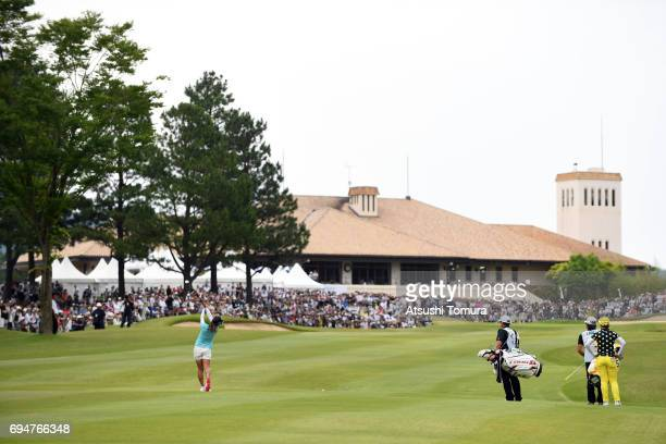Ai Miyazato of Japan hits her second shot on the 9th hole during the final round of the Suntory Ladies Open at the Rokko Kokusai Golf Club on June 11...